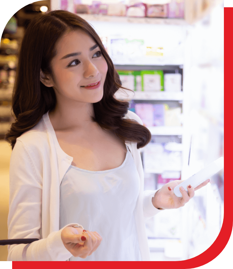Girl looking at shelf with products